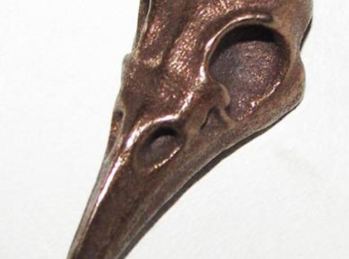 Raven Skull Pendant 3d printed Photograph of the Raven Skull Pendant in Antique Bronze Glossy