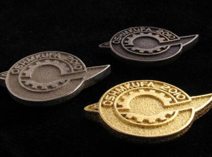 FGL Badge 3d printed Front to Back: Gold/Stainless/Bronze.