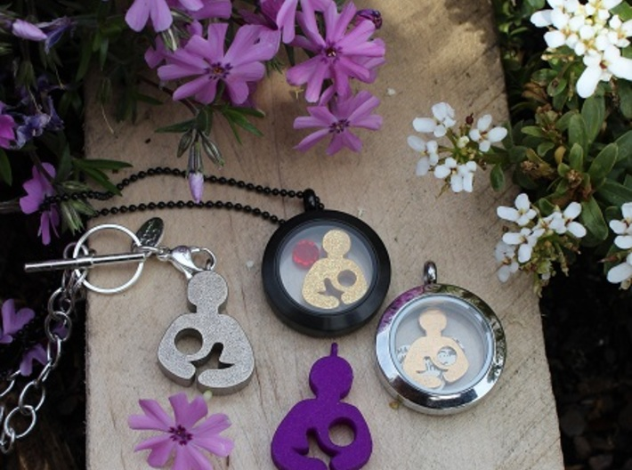 Breastfeeding Pendant 3d printed Breastfeeding Pendant (in Polished Nickel Steel and Purple Violet Strong & Flexible Plastic).  Also pictured Origami Owl Charm and Plate