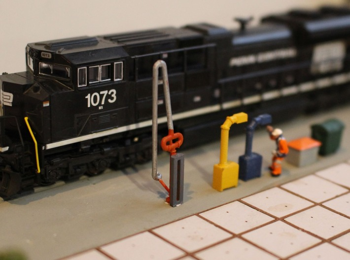 N Scale 4x Fuel Crane #1 Long 3d printed Fuel crane next to the boom cabinets