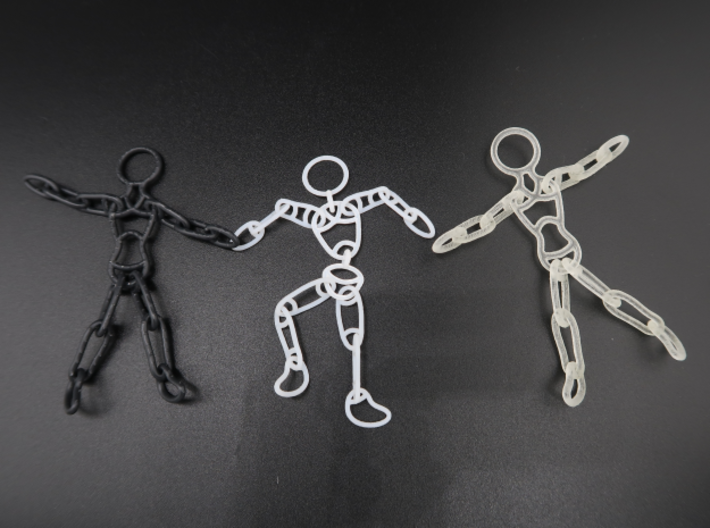 Ragdoll Pendant (5 parts) 3d printed Black Hi-Def Acrylate and Transparent Acrylic, surrounding their 11-part sibling.