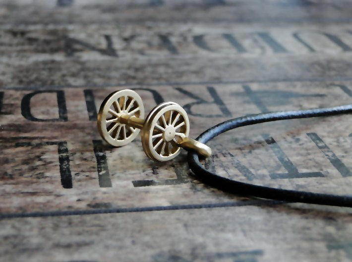 Pendant Train Axle 3d printed Polished Brass -Necklace not included.