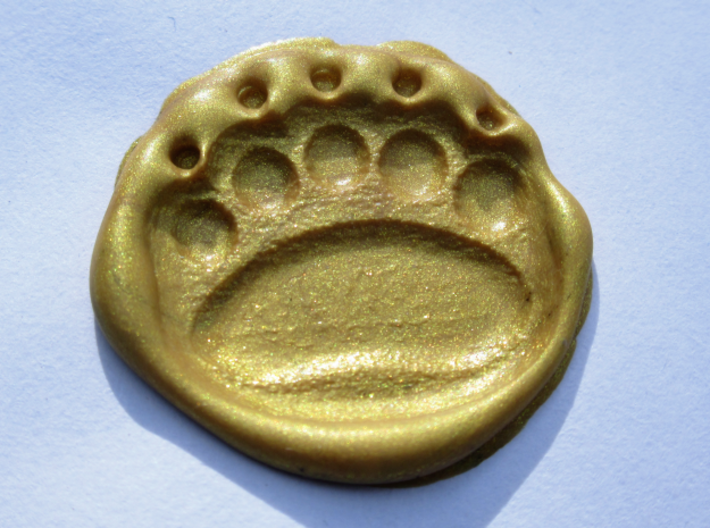 Teddybear clawed-paw wax seal 3d printed A left paw-print in golden wax