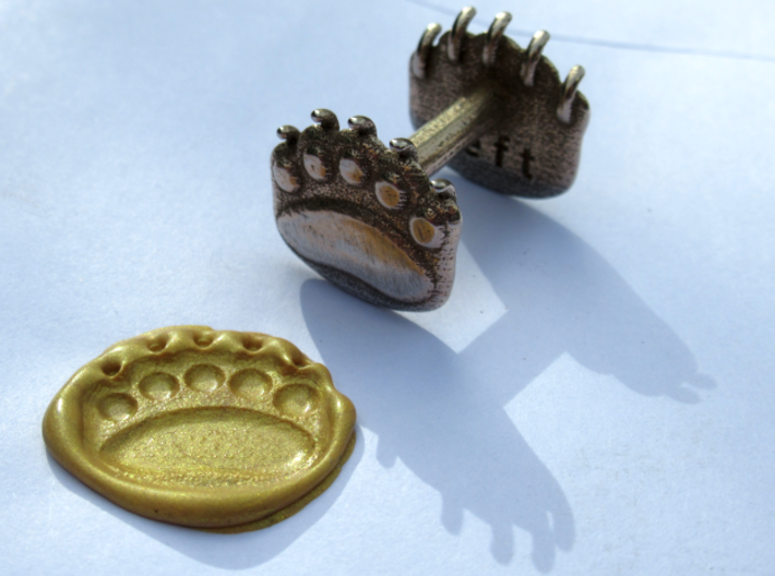 Teddybear clawed-paw wax seal 3d printed golden wax from a wicked stick of sealing wax