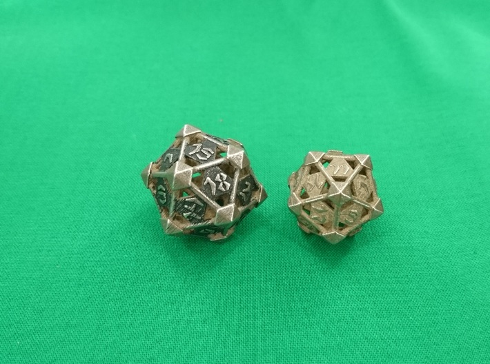 Prism D20 3d printed Prism D20 Large in polished bronze silver steel painted to raise contrast (left) and medium unpainted.