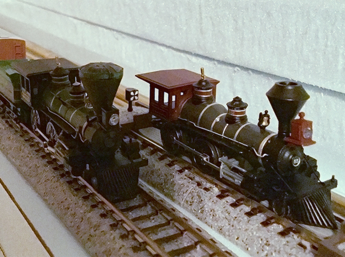 N Scale Locomotive 'Bonnet' Stack (Single) 3d printed A stock Atlas 4-4-0 stationed next to the William Mason with printed 'bonnet' stack (left).