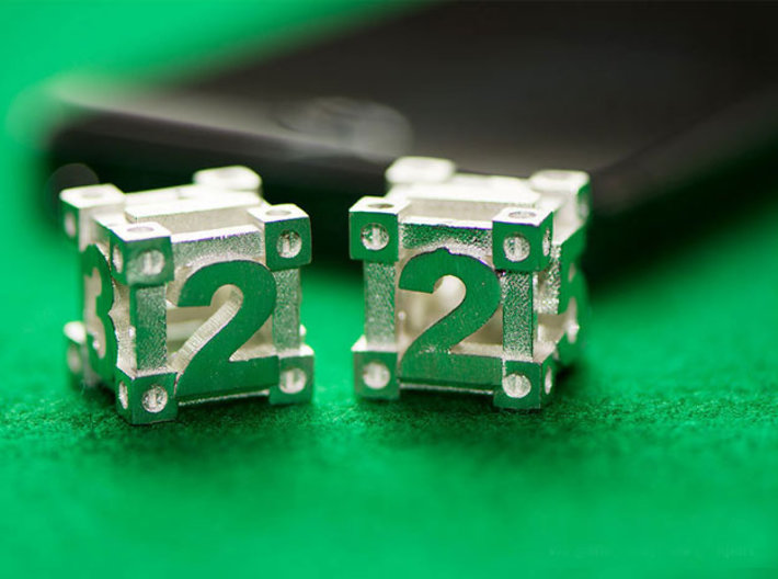 Ultimate Game Dice 3d printed Dice in photo are Raw Silver