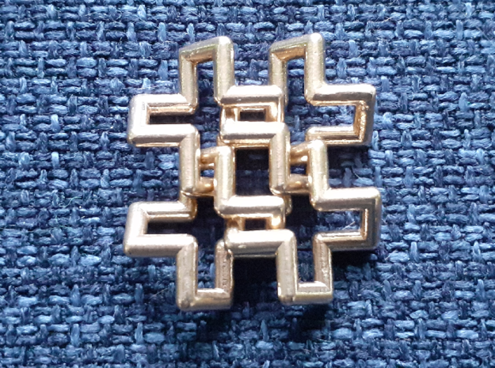 Hash Tag Pendant 3d printed Bronze on blue pillow