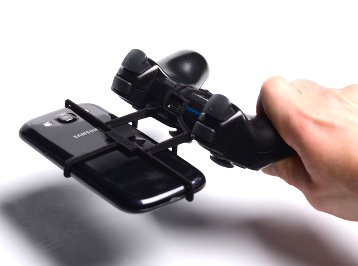 PS3 controller & Huawei Ascend P7 Sapphire Edition 3d printed In hand - A Samsung Galaxy S3 and a black PS3 controller