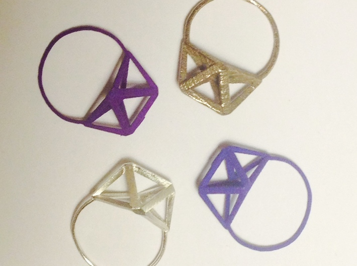 Amplituhedron Ring  3d printed Steel, blue, raw silver and purple are shown here
