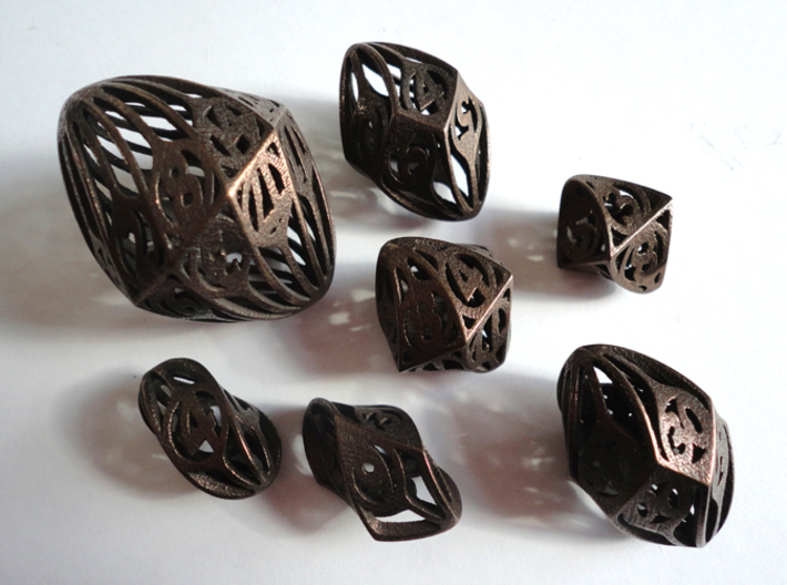 Twisty Spindle Dice Set with Decader 3d printed In Polished Bronze Steel