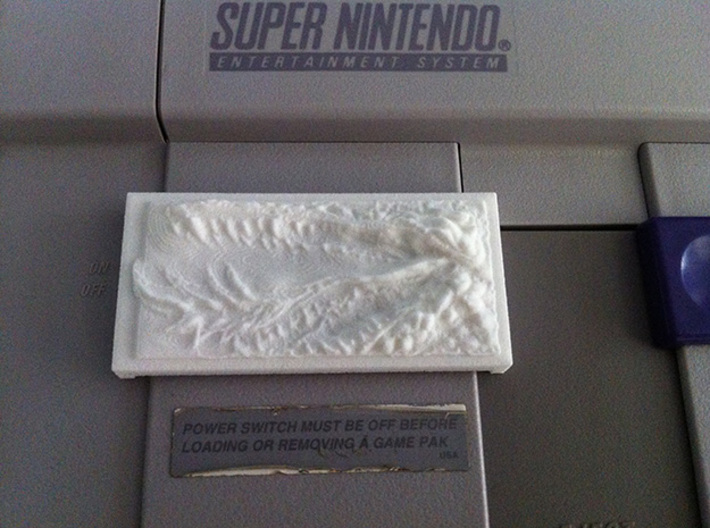 DragonMouth Plastic Power/Reset Button Cover 3d printed The cover in use on an SNES unit.