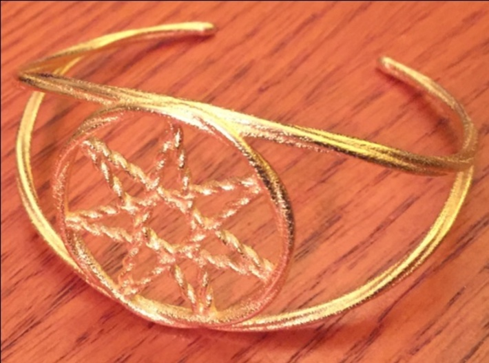 Woven Fairy Star armband/cuff 3d printed The woven fairy star (heptagram) armband in polished gold over steel.