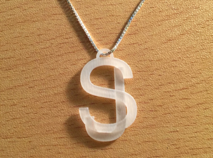Overlaid Letter Charm 3d printed 3D printed in Frosted Ultra Detail for transparency effect. Note: Chain not included.