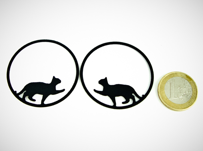 Give Me Some Food Cat Hoop Earrings 40mm 3d printed Give Me Some Food Cat Hoop Earrings 40mm printed in Black Strong & Flexible with 1€ coin for scale.