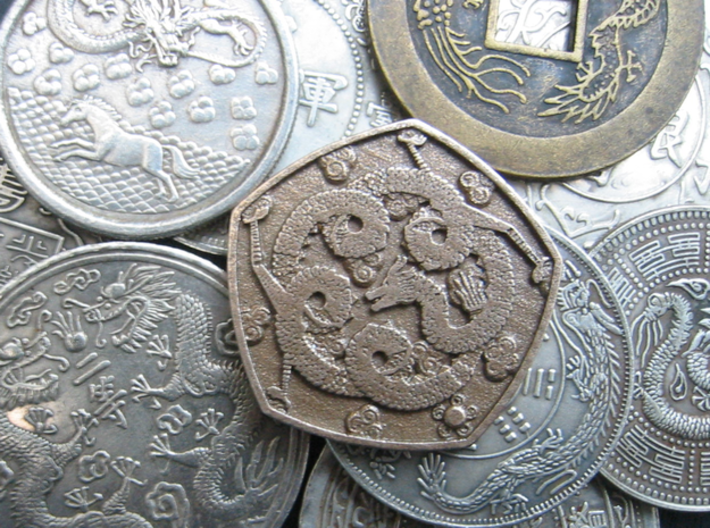 Steel Dragon Coin 3d printed Pentagonal steel dragon coin shown with my collection of oriental coins and charms