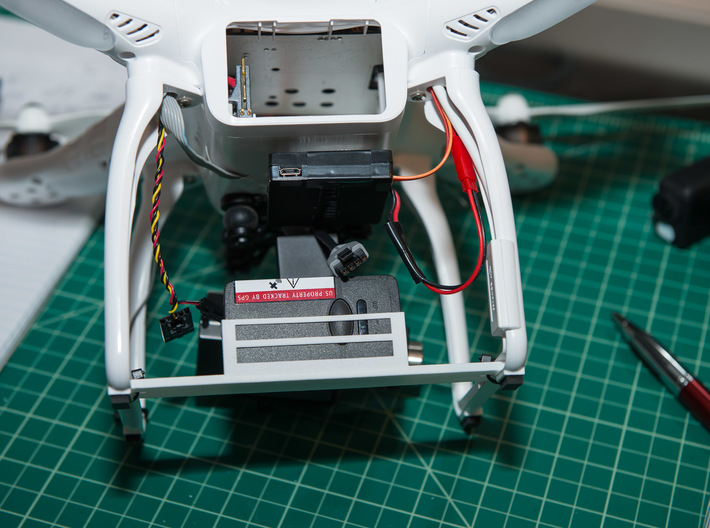 UAV Locator Holder for DJI Phantom 3d printed Secured to landing gear bottom groves then zipties thru hole