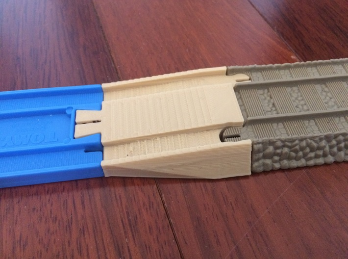 Male Tomy to Trackmaster Adapter 3d printed Test print done on consumer 3d printer. Part ordered from Shapeways will be exactly the same size but professionally printed at higher quality.