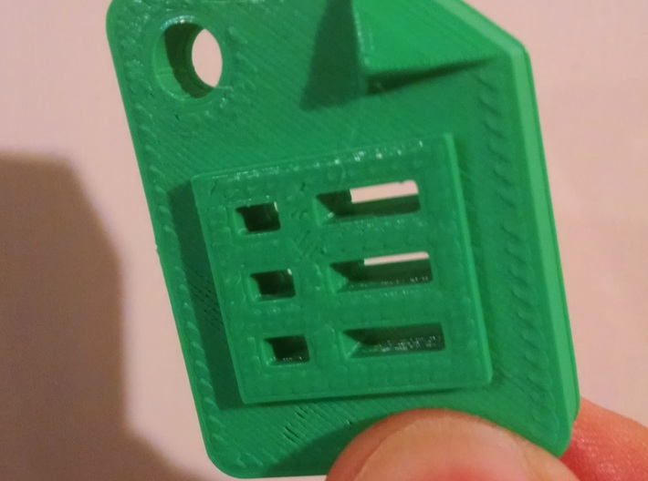 Google Sheets Icon (size: Tiny) for Keychain / Cha 3d printed this is an image of a print done by a printer outside of shapeways