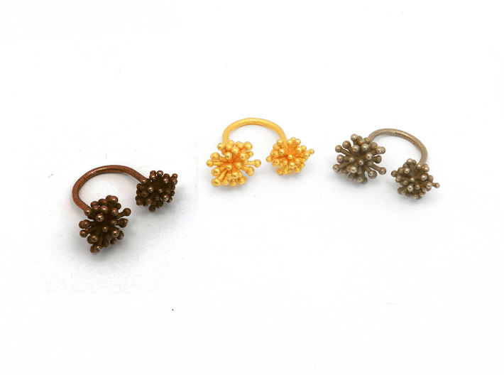 Double Starburst Ring 3d printed polished bronze steel, polished gold steel, stainless steel