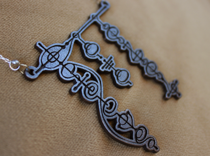 """Live Long and Prosper"" Vulcan Script Pendant 3d printed Pictured: Polished Grey Steel"