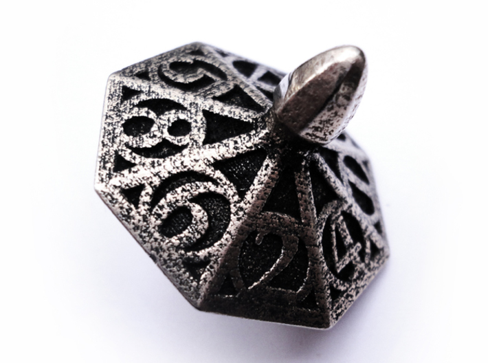 Top d8 3d printed In stainless steel and inked.