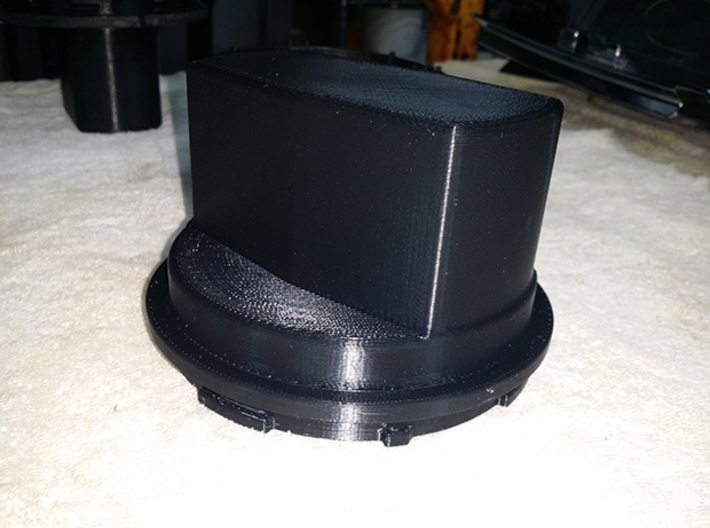 A single Thinner Extended Silverado headlight cap 3d printed These are pictures of the prototyping models so you can see the size and how they fit.
