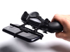 PS4 controller & Wiko Goa 3d printed In hand - A Samsung Galaxy S3 and a black PS4 controller