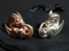 Dragon Baby Talisman 3d printed Raw Bronze and Polished Silver Materials