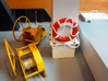 Life Belt 1/25 (1 pc.) 3d printed Ropes attached and life belt placed on board a small towboat.