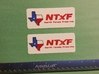 NTxF Tag 3d printed Printed part painted with red and blue enamel