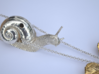 Descending Snail Pendant, part 1 3d printed Polished silver snail with gold plated brass leaf (photo)