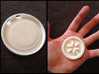 Sage Medallions 3d printed 2 holes on top for string or small chains. Placed on hand for size reference.