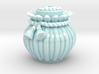Ribbed Jar And Skull-Faced Lid 3d printed