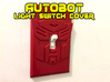 Autobot Faction Symbol Light Switch Plate 3d printed white, strong and flexible print, painted with red spraypaint