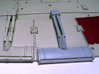 YT1300 DEAGO ENGINE LOUVER ARM W PLATE 3d printed Comparison with the stock part.