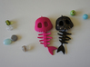 Mermaid Bone 3d printed Shown materials are Pink Strong & Flexible and Black Strong & Flexible dusted with gold spray