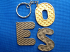 Patterned Letter Steel Keychain 3d printed Samples - O in polished gold steel, E and S in stainless steel
