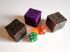 Labyrinthine Die6 3d printed A size comparison of the die in polished bronze steel, purple strong and flexible, and stainless steel with normal dice