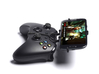 Xbox One controller & HTC Desire 526G+ dual sim  - 3d printed Side View - A Samsung Galaxy S3 and a black Xbox One controller